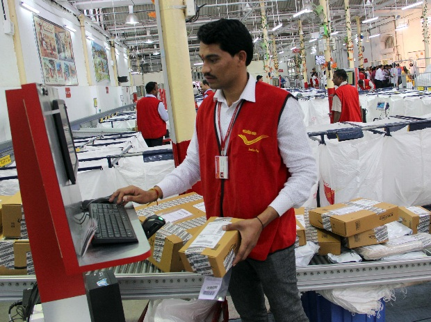 An employee at India Post's e-Commerce Parcel Processing Centre in Mumbai